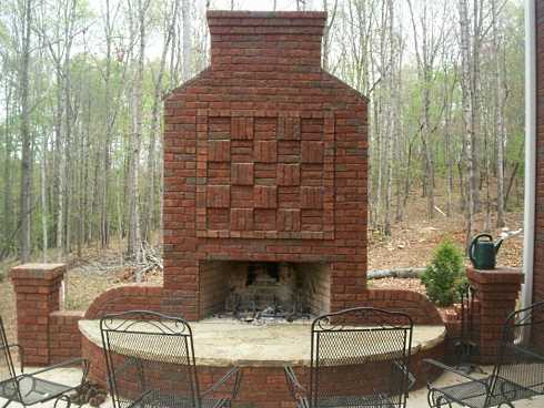 the stunning brick outdoor fireplace pictured below features rather