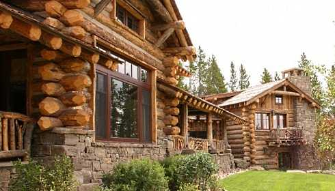 Standout rustic stone fireplaces rugged revered for Log and stone house plans