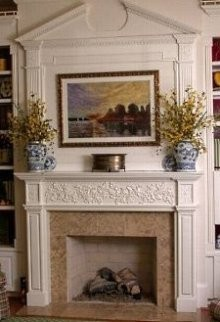 how to create a more imposing fireplace surround by extending it upward - Fireplace Surround Design Ideas