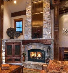 Custom stone fireplace hearth ideas come from a long and rich legacy of stone fireplace design . . . with no shortage of fresh and innovative ideas for new designs!