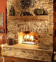 Manufactured stone fireplaces have come a long way in recent years. Their realistic appearance and lower cost make them a viable alternative to natural stone.