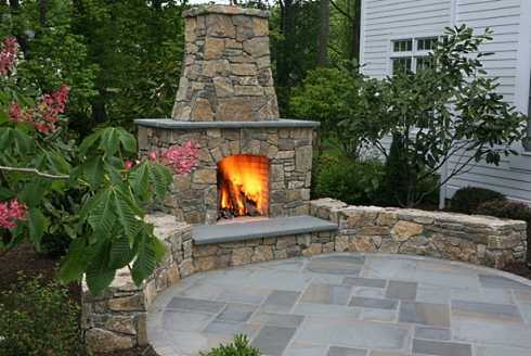 The outdoor patio fireplace designs featured here range from soaring hearths attached to the home