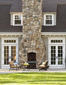 Hot outdoor stone fireplace designs heat up your summer for Back to back indoor outdoor fireplace