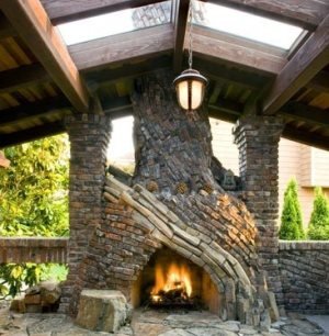 Striking patio designs for outdoor fireplaces featuring both brick and stone hearths