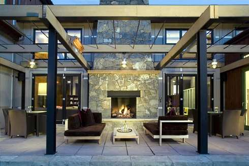 side patio designs. The small but elegant pergola pictured at right  provides a perfect