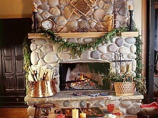 A river stone fireplace is the quintessential ideal of a nostalgic hearth.  It conjures up images of a time when life   was simpler...and seemingly sweeter.