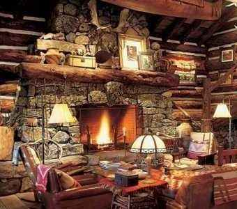 Rock fireplaces on lakeside home designs