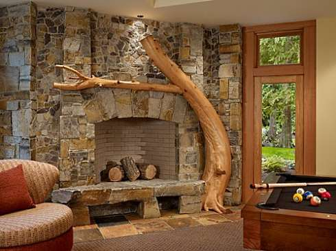 The stone fireplace design ideas presented here feature a collection of striking floor-to-ceiling stone surrounds that is truly unique and distinctive...and designed to stand apart from the crowd!