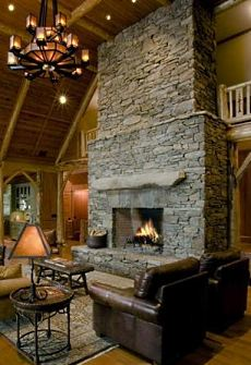 The stone fireplace hearth . . . few things are as warm and inviting as a crackling wood fire in a cozy stone fireplace!
