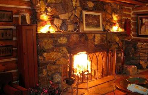 Cozy By The Fireplace The Cozy Stone Fireplace.rest And Relax In A Rustic Setting