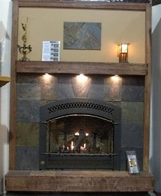 Wood fireplace mantel shelves are a great way to top off a tile