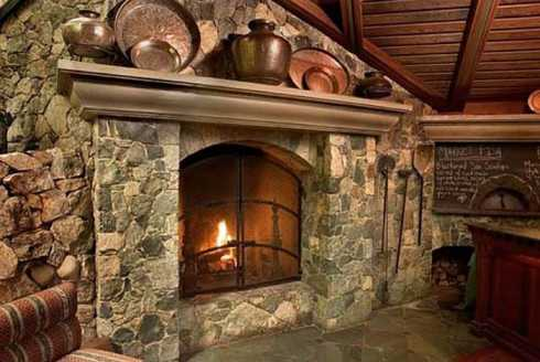 The country stone corner fireplace cozy casual for Country stone fireplace