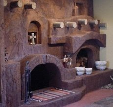 The kiva fireplace steppin 39 up out southwest style for Kiva fireplaces