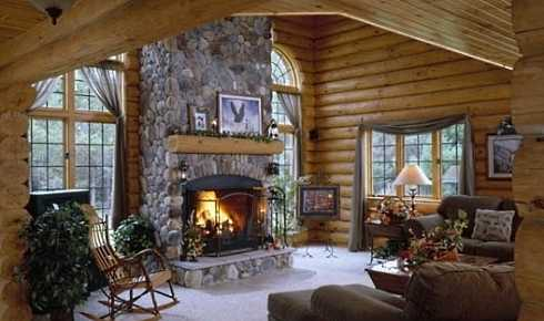Standout riverstone fireplaces cozy cabin hearths for Log cabin fireplace designs