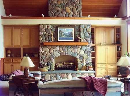 stone surround fireplace with built ins